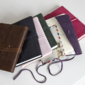 Leather bound tie journal in bright colours
