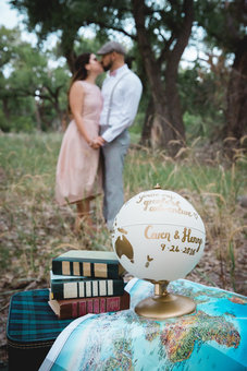 Couple with gold personalised globe engagement photoshoot