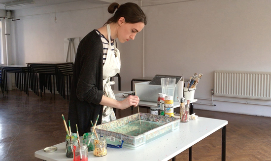 Lucy McGrath of Marmor Paperie making marbled paper in studio