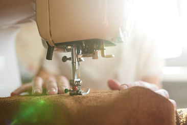 Once the leather pieces have been cut from our unique patterns, the pieces are glued and machine stitched into place.