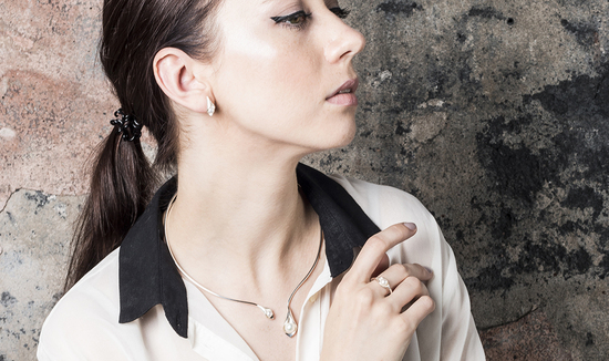 Model wears Emma-Kate Francis Calla Lily Collection jewellery made from sterling silver and freshwater pearls