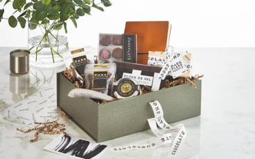 The Dapper Chap Grande, filled with a selection of edible items and keepsake gifts.