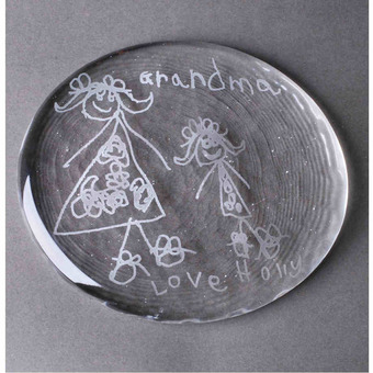 Children's drawing on crystal glass paperweight