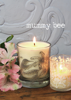 Natural wax candles in printed glassware