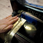 Handcrafting leather accessories on a vintage Singer Sewing machine in our studio