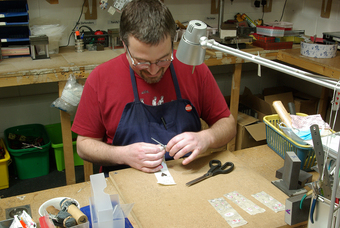 Dave preparing the cut out hearts for drilling