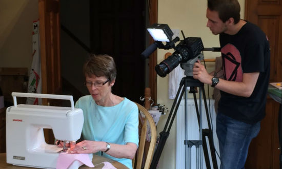 Joanne sewing while being filmed
