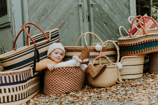 Baby Moses Basket & Vintage Moroccan Rugs