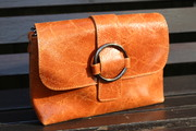 Vintage look tan printed suede messenger bag with silver buckle detail.