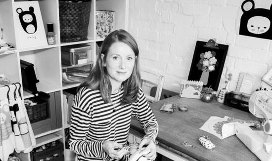 Hannah in her studio sewing a handmade kids cushion