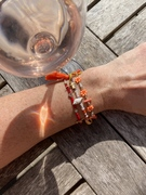 Happiness is ... a glass of rosé and a Clarke Palmer bracelet stack.