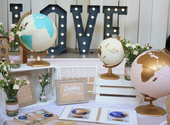 Loobie Design globes displayed on table