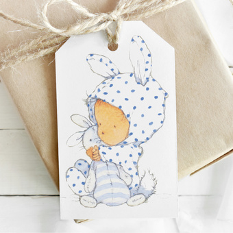 Little baby watercolour illustration on a gift tag to match wrapping paper