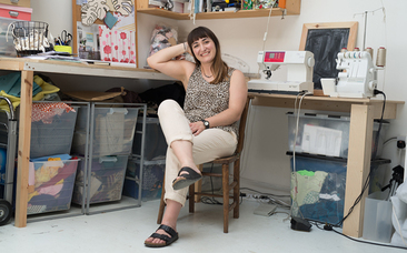 Erin Plant in Too Many Pjs studio with sewing machine