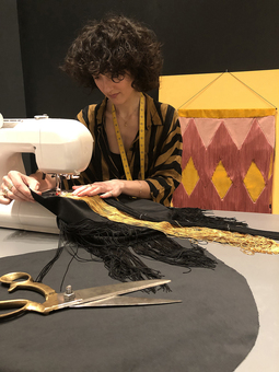 Founder Eleanor Nadimi making wall hanging One Nine Eight Five