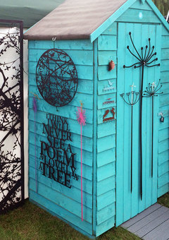 Garden shed with wall art