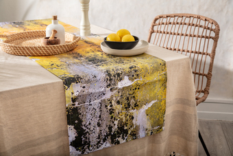 natural texture yellow table runner, lemons in black bowl