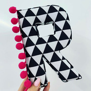 Monochrome triangles & bright pink pompoms