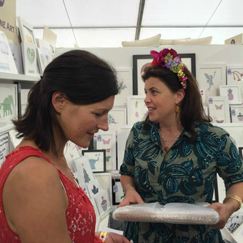 Kirstie Allsopp purchasing a framed picture at The Handmade Fair, Hampton Court