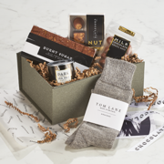 The Dapper Chap Mini, a gift filled with a collection of conefectionary items and alpaca socks.