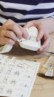 Applying transfers to ceramics by hand