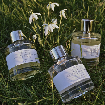 Three Perfumes in grass fields