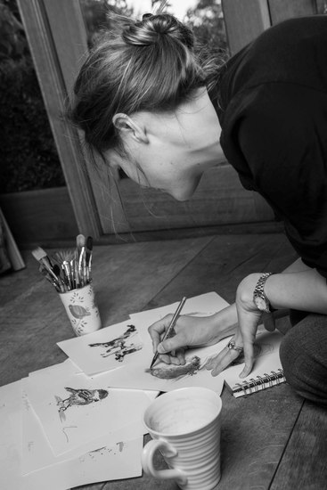 Zaza Shelley sketching in her studio.