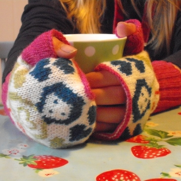 Knitted lambswool Russian doll hand warmers