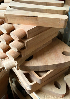 Machined pieces of solid oak pile up in the workshop during production of our personalised wooden gifts and furniture