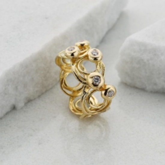 Swirly gold and diamond shimmering ripples ring