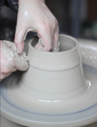 Throwing clay on the potter's wheel