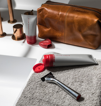 Cornerstone razor with skincare products and wash bag
