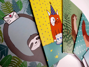 A selection of greetings cards featuring illustrations of animals.