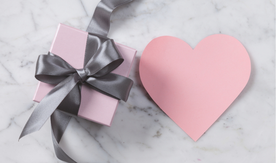 Pink gift wrapped in grey ribbon with a pink heart