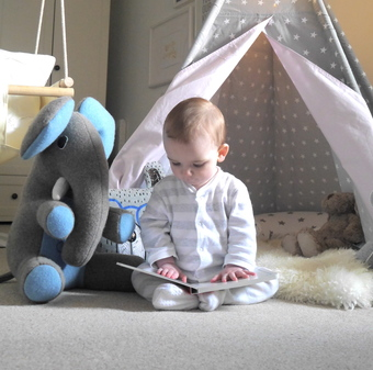 boy reading to his elephant