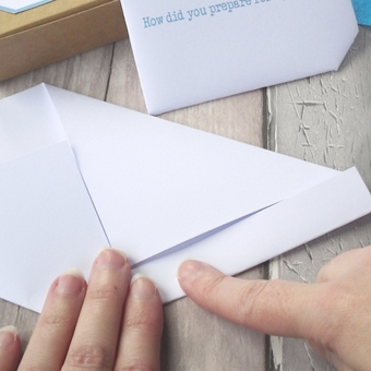 Folding a letter for a box of letters from Mummy to her baby.