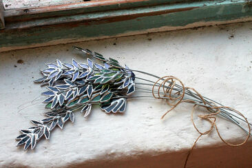 Rustic bundle of stained glass wildflowers tied with string