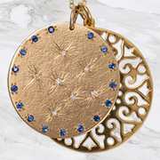 9ct Yellow Gold medal with set Diamonds and Blue sapphires with a  large lace flower disc pendant