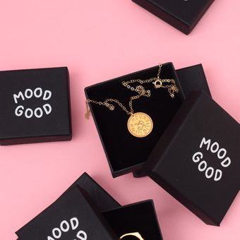 Mood Good jewellery boxes with gold necklace on pink background