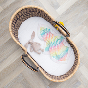 Rainbow Comforter in a Bassinet