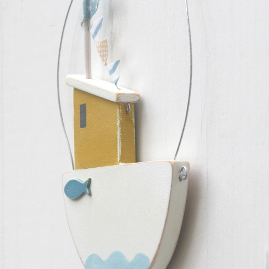 Wooden painted hanging fishing boat personalised for a child's gift