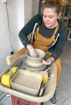 Fi from FICH ceramics throwing on the potter's wheel