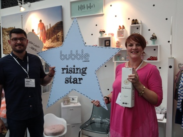 Catriona and her husband, Luay in front of their winning stand at Bubble London