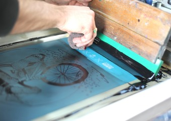 Huddersfield Screenprinting Co with squeegee