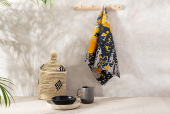 black and yellow tea towel, global inspired basket