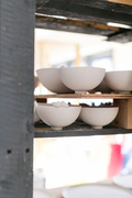 cearmic tweet bowls drying on studio shelves
